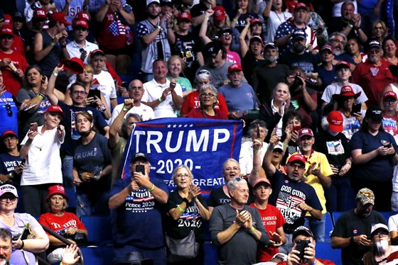 Inside Trump's Tulsa rally, no distancing despite empty seats, few masks and plenty of doubt about coronavirus